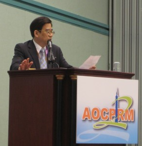 Simon Tang at podium for AOCPRM, Taipei